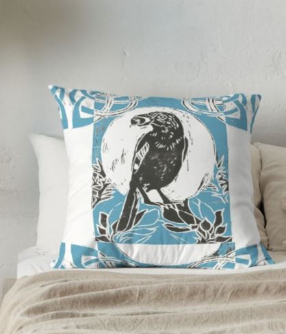 Jay in Gorse blue pillow on bed